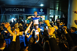 © Licensed to London News Pictures. 09/05/2021. Bolton, UK. EOIN DOYLE is lifted on to the shoulders of HARRY BROCKBANK outside the stadium hotel . Bolton Wonderers supporters celebrate outside the University of Bolton stadium as their team coach returns home following BWFC winning promotion to League One after the team's 1-4 victory over Crawley Town . Photo credit: Joel Goodman/LNP