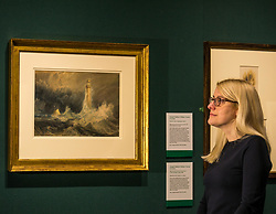 Pictured: Curator Charlotte Topsfield admires the Bell Rock lighthouse painting by Turner. Turner art exhibition. For more than a century the National Galleries of Scotland (NGS) have displayed an outstanding collection of Turner watercolours, from the 38 paintings bequeathed by Henry Vaughan in 1900. His will stipulated that the paintings should only be shown in January when daylight in Edinburgh is weak. The annual exhibition by artist Joseph Mallord William Turner (1775-1851) is supported by players of People's Postcode Lottery for the 7th year running. The focal point is a dramatic portrait of the Bell Rock lighthouse built by Robert Stevenson (1772-1850) which was commissioned 200 years ago by the lighthouse engineer to illustrate his book 'Account of the Building of Bell Rock Lighthouse'. Bell Rock is the oldest surviving rock lighthouse in the British Isles, first lit in 1811. It stands on a partially submerged reef near Angus, regarded by sailors as among the most dangerous places on the east coast of Scotland. The exhibition opens on New Year's Day at Scottish National Gallery and last for one month. 20 December 2018  <br /> <br /> Sally Anderson   EdinburghElitemedia.co.uk