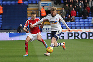 Nottingham Forest's Jamie Paterson (l) competes for the ball against Bolton Wanderer's Tim Ream. Skybet championship match, Bolton Wanderers v Nottingham Forest at the Reebok Stadium in Bolton, England on Saturday 11th Jan 2014.<br /> pic by David Richards, Andrew Orchard sports photography.