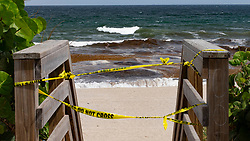 October 2, 2018 - Lake Worth, Florida, U.S. - Waves break at Phipps Ocean Park in Palm Beach. A red tide outbreak has prompted the beach to be closed. (Credit Image: © Allen Eyestone/The Palm Beach Post via ZUMA Wire)