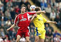 Photo: Chris Ratcliffe.<br />Leyton Orient v Peterborough United. Coca Cola League 2. 29/04/2006.<br />Craig Easton (L) of Leyton Orient tussles with Peter Gain of Peterborough.