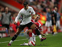 Photo: Lee Earle.<br /> Charlton Athletic v Manchester United. The Barclays Premiership. 23/08/2006. Charlton's Luke Young (R) clashes with Cristiano Ronaldo.