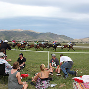 Spectators watch the horse racing during a day at the Races at the Cromwell Race meeting, Cromwell, Central Otago, New Zealand. 27th November 2011. Photo Tim Clayton