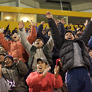 'Attitude at Altitude' Football in Potosi, Bolivia'..Real Potosi fans celebrate a goal for the home side during a night match between Real Potosi and Universitario Sucre at the Estadio Victor Agustin Ugarte, home of Bolivian football team Real Potosi. Real Potosi won the match 4-3. Potosi, Bolivia, 12th May 2010. Photo Tim Clayton....'Attitude at Altitude' Football in Potosi, Bolivia'..The Calvario players greet the final whistle with joyous celebration, high fives and bear hugs the players are sprayed with local Potosina beer after a monumental 3-1 victory over arch rivals Galpes S.C. in the Liga Deportiva San Cristobal. The Cup Final, high in the hills over Potosi. Bolivia, is a scene familiar to many small local football leagues around the world, only this time the game isn't played on grass but a rock hard earth pitch amongst gravel and boulders and white lines that are as straight as a witches nose, The hard surface resembles the earth from Cerro Rico the huge mountain that overlooks the town. .. Sitting at 4,090M (13,420 Feet) above sea level the small mining community of Potosi, Bolivia is one of the highest cities in the world by elevation and sits 'sky high' in the hills of the land locked nation. ..Overlooking the city is the infamous mountain, Cerro Rico (rich mountain), a mountain conceived to be made of silver ore. It was the major supplier of silver for the spanish empire and has been mined since 1546, according to records 45,000 tons of pure silver were mined from Cerro Rico between 1556 and 1783, 9000 tons of which went to the Spanish Monarchy. The mountain produced fabulous wealth and became one of the largest and wealthiest cities in Latin America. The Extraordinary riches of Potosi were featured in Maguel de Cervantes famous novel 'Don Quixote'. One theory holds that the mint mark of Potosi, the letters PTSI superimposed on one another is the origin of the dollar sign...Today mainly zinc, lead, tin and small quantities of silver are extracted from