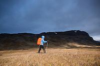 Dramatic stormy light on female hiker in Alisvagge along kungsleden Trail, Lappland, Sweden