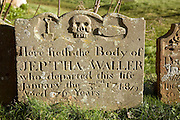 Old gravestone decorated with skull and bones, Ramsholt, Suffolk, England