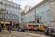 A tram passing through a busy Luis de Camoes square on the 29th of October 2019, Lisbon, Portugal.