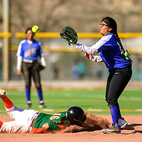 Wingate Bear Harriet Thompson  (16), left, dives back to second base safe before Navajo Pine Warrior Shuridan Stewart (12) receives the throw during the Wingate Softball Slam tournament at Ford Canyon Park in Gallup Friday.