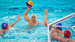 Jesse Nispeling, Eelco Wagenaar, Thomas Lucas of the Netherlands in action against Marko Petkovic of Montenegro during the Olympic qualifying tournament. The Dutch water polo players are on the hunt for a starting ticket for the Olympic Games on February 19, 2021 in Rotterdam