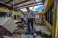 Rutledge Rogers, front, Jon Cicio, at center, and Tim Davis left, members of the Gainesville Fire Rescue Urban Search and Rescue Team walk through buildings searching for bodies after the destruction caused by Hurricane Dorian in Marsh Harbour on Abaco Island on Sunday, September 8, 2019.