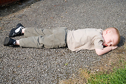 Young boy; fallen down and hurt himself,