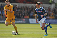 George Donnelly of Rochdale (right) takes on Kevin Feely of Newport. Skybet football league two match, Newport county v Rochdale at Rodney Parade in Newport, South Wales on Saturday 3rd May 2014.<br /> pic by Mark Hawkins, Andrew Orchard sports photography.