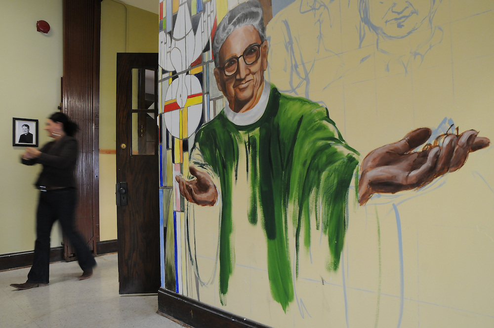A mural and photo depicting former St. Eulalia Pastor William Quinn adorns the entryway of a new community center in his name, painted by artist Rachel Ryan. The former parish school had been underutilized for several years until current Pastor Carmelo Mendez began an initiative to breathe new life into the building with a few coats of paint and hard work. Pastor William Quinn made a lasting history for himself as a pioneer for social justice, both in the fields of civil rights, along with those of immigrants in the U.S. He died in 2004.
