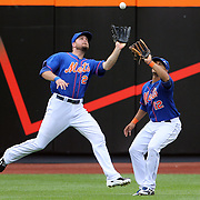 Lucas Duda, (left) steps in front of team mate Juan Lagares, New York Mets, to take an outfield catch during the New York Mets V Miami Marlins, Major League Baseball game which went for 20 innings and lasted 6 hours and 25 minutes. The Marlins won the match 2-1. Citi Field, Queens, New York. 8th June 2013. Photo Tim Clayton