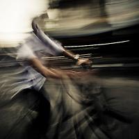 Riding bike at night, French Quarter, Hanoi, Vietnam