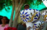 """MEXICO, Veracruz, Tantoyuca, Oct 27- Nov 4, 2009. Hand-made unfired pottery in Santa Maria de Ixcatepec. """"Xantolo,"""" the Nahuatl word for """"Santos,"""" or holy, marks a week-long period during which the whole Huasteca region of northern Veracruz state prepares for """"Dia de los Muertos,"""" the Day of the Dead. For children on the nights of October 31st and adults on November 1st, there is costumed dancing in the streets, and a carnival atmosphere, while Mexican families also honor the yearly return of the souls of their relatives at home and in the graveyards, with flower-bedecked altars and the foods their loved ones preferred in life. Photographs for HOY by Jay Dunn."""