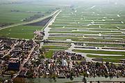 Nederland, Noord-Holland, Gemeente Schermer, 28-04-2010; Schermerhorn met Hervormde kerk, de polder Eilandspolder op het tweede plan.luchtfoto (toeslag), aerial photo (additional fee required).foto/photo Siebe Swart