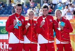 England's Alistair Brownlee (left) Jessica Learmonth, Jonathan Brownlee and Vicky Holland celebrate taking silver during the Mixed Team Relay Triathlon final at the Southport Broadwater Parklands during day three of the 2018 Commonwealth Games in the Gold Coast, Australia.