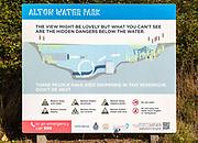 Alton Water reservoir lake, Suffolk, England, UK notice warning of hidden submerged dangers