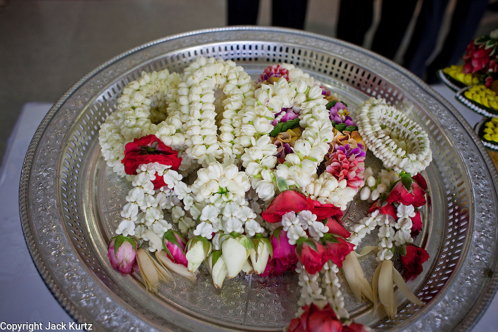 Sept. 22, 2009 -- BANGKOK, THAILAND:  Flower garlands for King Bhumibol Adulyadej, the 81-year-old King of Thailand. The King has been admitted to hospital suffering from a fever. Doctors at Siriraj Hospital said the world's longest-serving monarch, had shown signs of fatigue and was being treated with antibiotics. King Bhumibol is deeply revered by most Thais and his health is a matter of public anxiety. His Majesty was admitted on Saturday suffering from a fever, fatigue and loss of appetite. Doctors continued to treat the King with intravenous drips and antibiotics, hospital officials said. More than 3,500 people have come to the hospital to pray for the King's speedy recovery and to sign get well cards for him.  Photo by Jack Kurtz