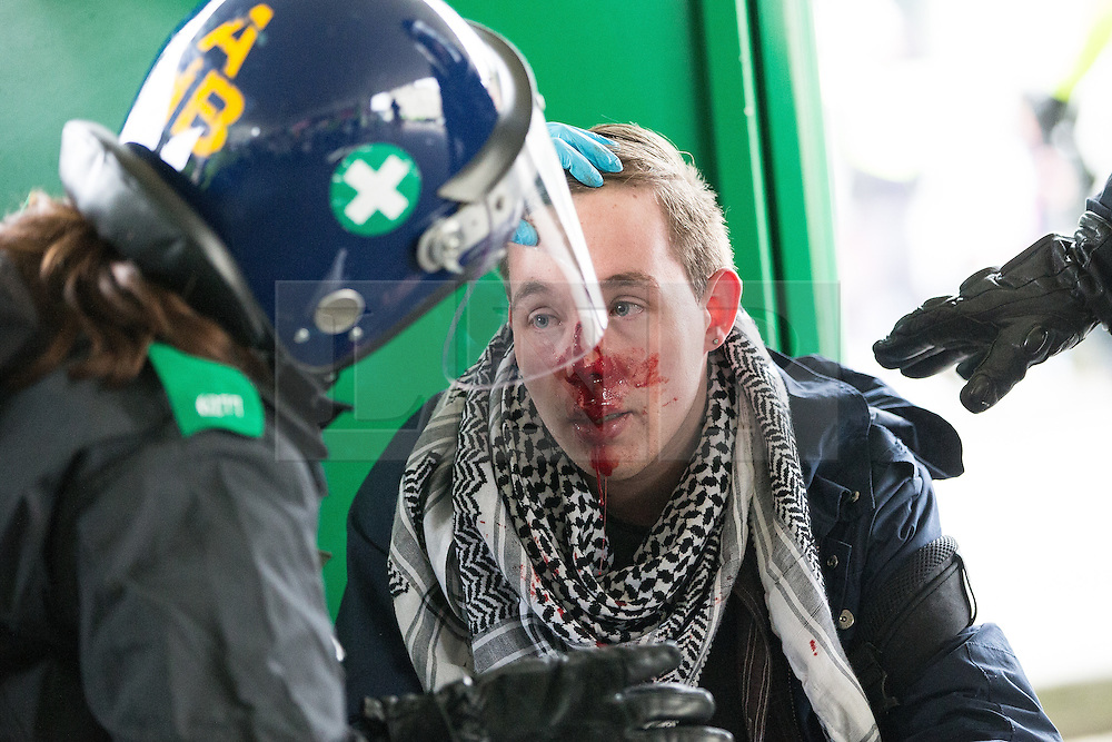 © Licensed to London News Pictures . 30/01/2016 . Dover , UK . An injured anti fascist protester at the demonstration . Demonstrations by far-right groups (including The National Front , The North West Infidels and The South East Alliance ) and , opposing them , anti-fascists , close to the port of Dover in Kent . Photo credit : Joel Goodman/LNP