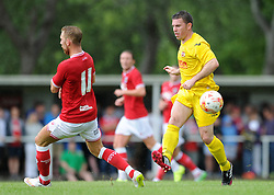 Scott Wagstaff of Bristol City closes down Brislington captain James Peart,  - Photo mandatory by-line: Dougie Allward/JMP - Mobile: 07966 386802 - 05/07/2015 - SPORT - Football - Bristol - Brislington Stadium - Pre-Season Friendly
