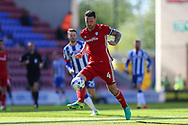 Sean Morrison of Cardiff City in action. EFL Skybet Championship match , Wigan Athletic v Cardiff city at the DW Stadium in Wigan, Lancs on Saturday 22nd April 2017.<br /> pic by Chris Stading, Andrew Orchard sports photography.
