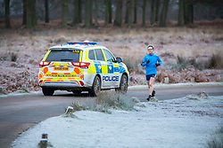 © Licensed to London News Pictures. 24/01/2021. London, UK. Police patrol a frosty Richmond Park this morning as members of the public enjoy a frosty start of the day with lows of -4 in South West London. A chilly day ahead is forecast for the South East with the Met Office issuing a yellow weather warning for snow and ice for today with disruption to travel as the cold weather continues. Photo credit: Alex Lentati/LNP