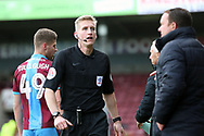 Referee Scott Oldham comes across to have a word with Plymouth Argyll Manager Derek Adams   during the EFL Sky Bet League 1 match between Scunthorpe United and Plymouth Argyle at Glanford Park, Scunthorpe, England on 27 October 2018. Pic Mick Atkins