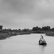 A vaccinator team on a boat on their way to a village on the flood plains of the Kosi river.
