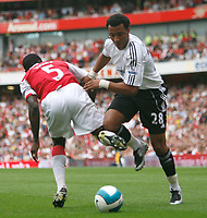 Photo: Steve Bond.<br />Arsenal v Derby County. The FA Barclays Premiership. 22/09/2007. Giles Barnes (R) manages to turn Kolo Toure (L)