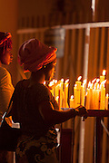 Women lighting candles, Cathedral of the Sacred Heart.