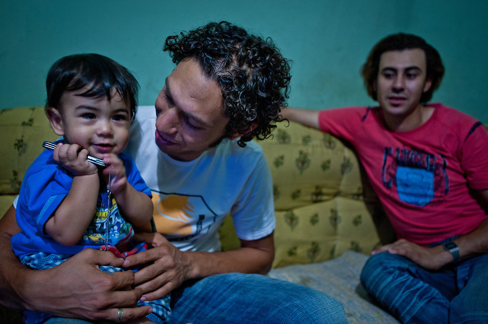 Hanna Fathy Rostum with his son at their home in Izbet az-Zabaleen. Hanna is an environmental pioneer who has joined with international non-profits to bring biogas digestors and homemade water heating units made from recycled materials to Izbet az-Zabaleen.