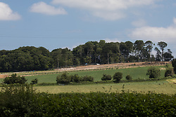 Wendover, UK. 16th June, 2021. Ancient woodland at Jones Hill Wood in Buckinghamshire is viewed from the A413 as works for the HS2 high-speed rail link continue (to the right of the image). A large section of the ancient woodland, which contained resting places and/or breeding sites for pipistrelle, barbastelle, noctule, brown long-eared and natterer's bats, has now been entirely cleared of trees and vegetation by contractors working on behalf of HS2 Ltd.