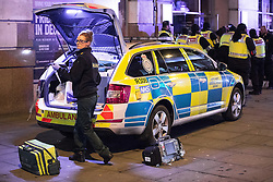 """© Licensed to London News Pictures . 24/12/2016 . Manchester , UK . A paramedic packs her equipment away , after tending to a man inside Tiger Tiger on Withy Grove . Revellers out in Manchester City Centre overnight during 2016's second """" Mad Friday """" , named for historically being one of the busiest nights of the year for the emergency services in the UK . Photo credit : Joel Goodman/LNP"""