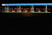 A new truck refueling island gleams in night lights at the TA Travel Centers of America in Morris, Illinois at Interstate 80 and Route 47.