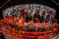 Red Candles are an age old traditional part of Buddhist rituals. They are placed in front of Buddhist shrines or statues and images of the Buddha as a mark of respect. The light of the burning candle flame represents the light of the Buddha's teachings, and it also be said to symbolize the enlightenment of the Buddha. Yuantong Buddhist Temple, Kunming, Yunnan Province, China.