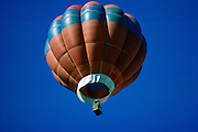 Hot air balloon flying above Dunstable Downs, Bedfordshire, United Kingdom RESERVED USE - NOT FOR DOWNLOAD -  FOR USE CONTACT TIM GRAHAM
