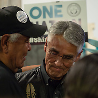 Stanley Bia, 58, on the left, shares a moment with 2018 Navajo Nation Presidential candidate Joe Shirley Jr., right, after Shirley/Nygren conceded due to the early results of the Navajo Nation Presidential election on Tuesday in Window Rock.