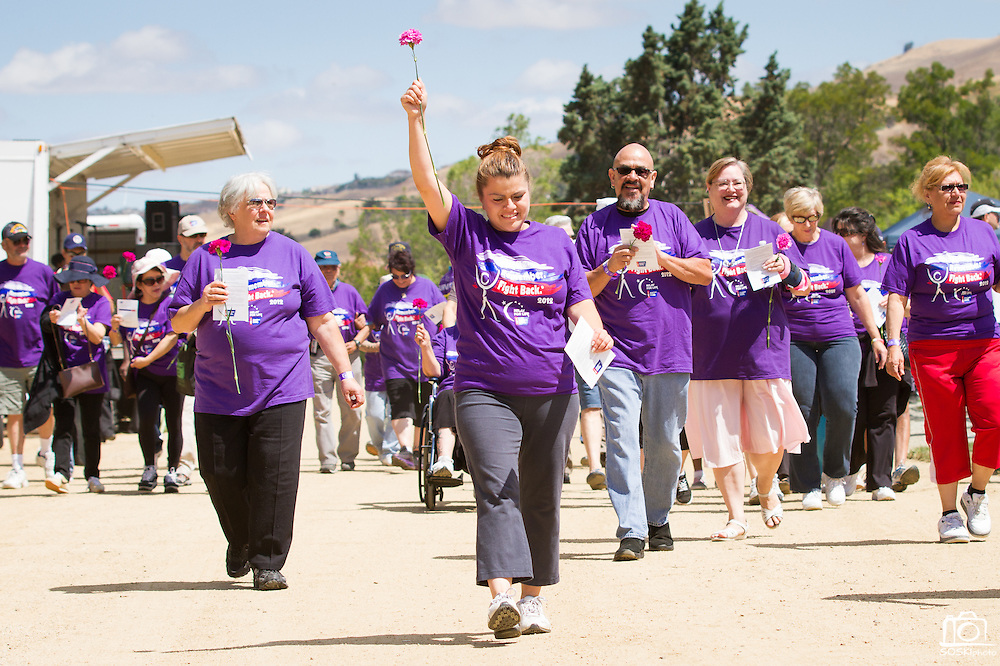Andrea Gadda, survivor of kidney cancer, leads the pack of Survivors around the Milpitas Sports Center track during the opening lap of Relay for Life on June 23, 2012.  Photo by Stan Olszewski/SOSKIphoto.