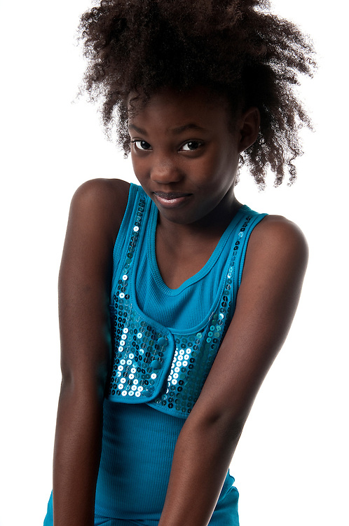 Young african american girl looking pensive and smiling.