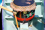 Drum in bow of dragon race boat to keep paddlers strokes in rhythm. Dragon Festival Lake Phalen Park St Paul Minnesota USA