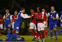 Fotball<br /> England 2004/2005<br /> Foto: SBI/Digitalsport<br /> NORWAY ONLY<br /> <br /> Coca Cola championship. 27/11/2004.<br /> <br /> GILLINGHAM V NOTTINGHAM FOREST<br /> <br /> Andy Impey and Tommy Johnson have words after Impeys clash with Rose