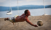 William Berrier of Post Falls lays out into the sand for a one-handed dig during the 17th Annual Hot Foot two-on-two beach volleyball tournament at North Idaho College Beach on Saturday. Teams played throughout the sweltering heat all day for cash and prizes for the top finishers.