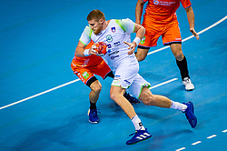 The Dutch handball player Kay Smits in action against Blaz Blagotinsek from Slovenia during the European Championship qualifying match on January 6, 2020 in Topsportcentrum Almere