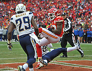 KANSAS CITY, MO - NOVEMBER 24:  Wide receiver Dwayne Bowe #82 of the Kansas City Chiefs catches a 5-yard touchdown pass against defensive back Shareece Wright #29 of the San Diego Chargers during the second half on November 24, 2013 at Arrowhead Stadium in Kansas City, Missouri.  San Diego won 41-38. (Photo by Peter Aiken/Getty Images) *** Local Caption *** Dwayne Bowe;Shareece Wright