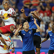 Thierry Henry, (left), New York Red Bulls, challenges for a cross with Sam Cronin, (centre), and Víctor Bernárdez, San Jose Earthquakes, during the New York Red Bulls Vs San Jose Earthquakes, Major League Soccer regular season match at Red Bull Arena, Harrison, New Jersey. USA. 19th July 2014. Photo Tim Clayton