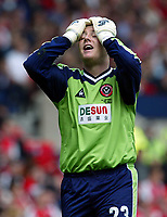 Photo Aidan Ellis.<br />Arsenal v Sheffield United (FA Cup Semi Final) <br />Old Trafford. 13/04/2003.<br />Sheffield keeper Paddy Kenny cant believe it as his team miss a chance to score