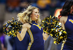 Jan 14, 2020; Morgantown, West Virginia, USA; A West Virginia Mountaineers dancer performs during the second half against the TCU Horned Frogs at WVU Coliseum. Mandatory Credit: Ben Queen-USA TODAY Sports
