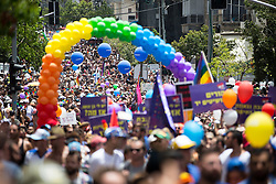 """© Licensed to London News Pictures . 03/06/2016 . Tel Aviv , Israel . Over 100,000 people attend the gay pride parade in Tel Aviv , reported to be the largest such event in the Middle East and Asia . The Israeli government has been accused of using the event as """" pinkwashing """" , marketing the event in order to deflect accusations of poor human rights behaviour . Photo credit: Joel Goodman/LNP"""